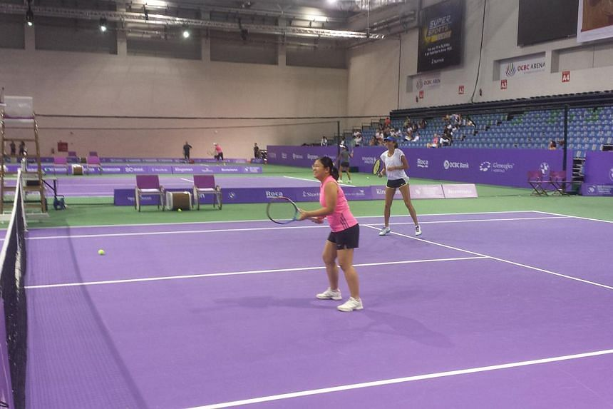 Iva Majoli (right) on court with a fan. -- ST PHOTO: DARYL CHIN