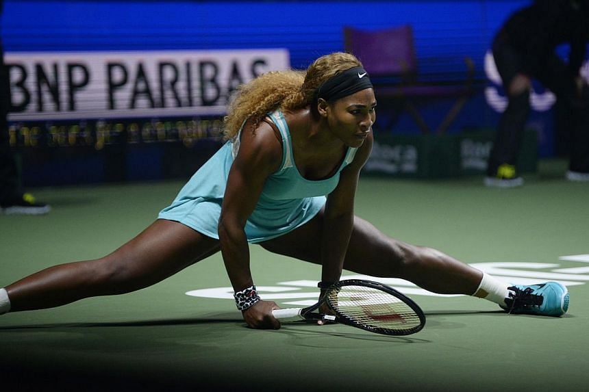 US tennis player Serena Williams doing a split during her match against Ana Ivanovic of Serbia. -- ST PHOTO:CAROLINE CHIA
