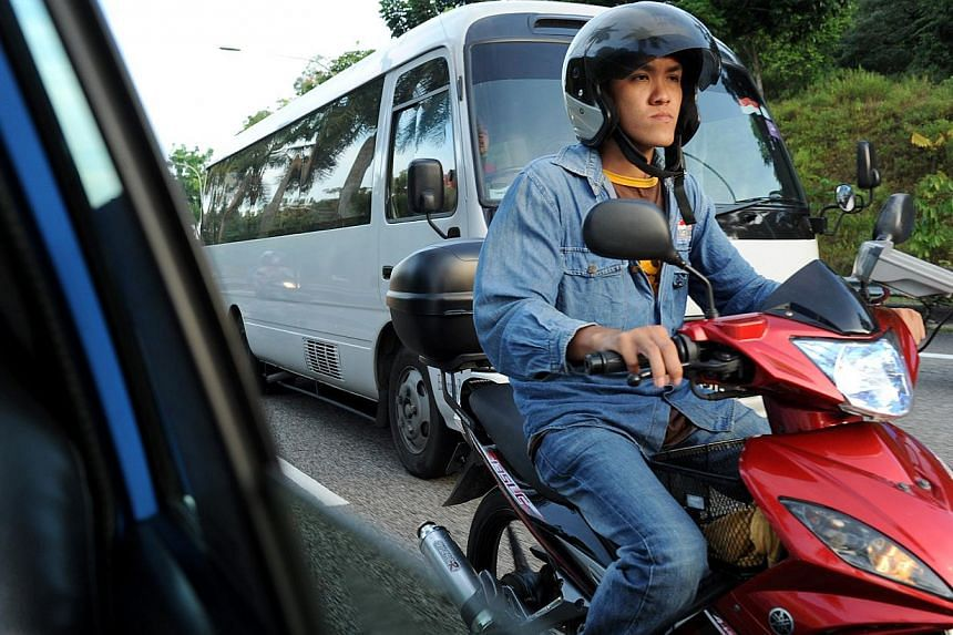 A motorcyclist weaves through the traffic along the BKE. -- ST PHOTO: NG SOR LUAN