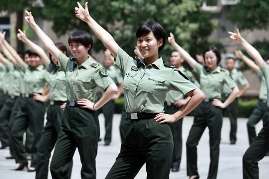 Soldiers dance to the popular song Little Apple in Xi'an, Shaanxi province, in this file picture. -- PHOTO: CHINA DAILY / ASIA NEWS NETWORK