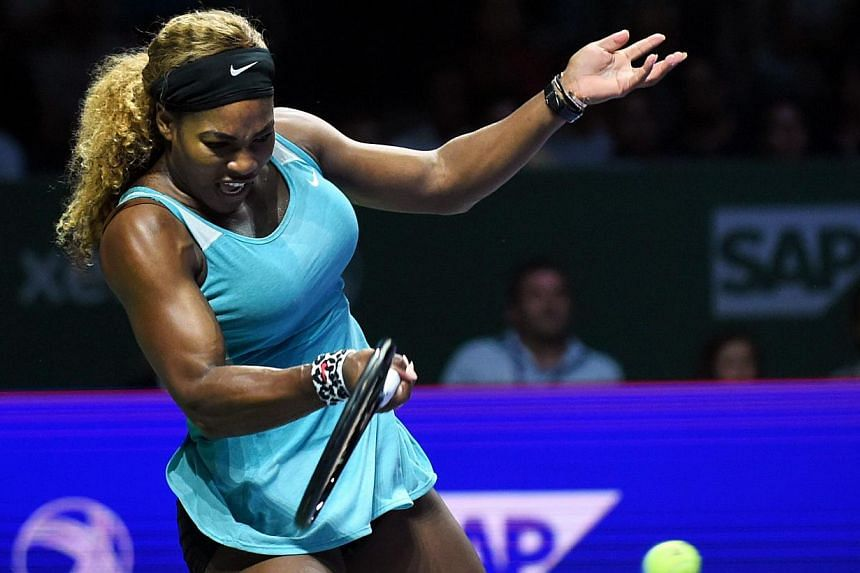 Serena Williams of the US returns the ball to Ana Ivanovic of Serbia during the Women's Tennis Association (WTA) championships in Singapore on Oct 20, 2014. -- PHOTO: AFP