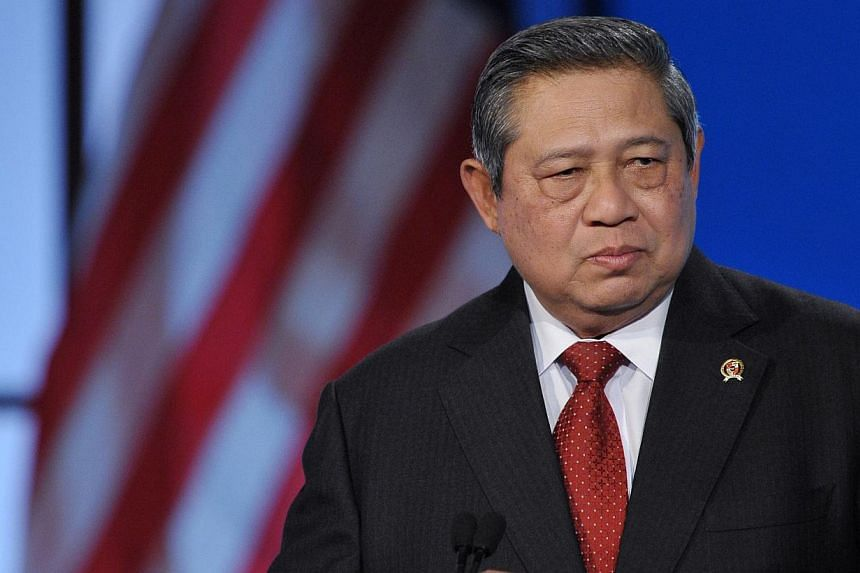 Indonesian President Susilo Bambang Yudhoyono on Sunday marked his last day in office with a message to his more than 5 million followers on Twitter, apologising for any offence he may have caused in his decade as head of state. -- PHOTO: AFP