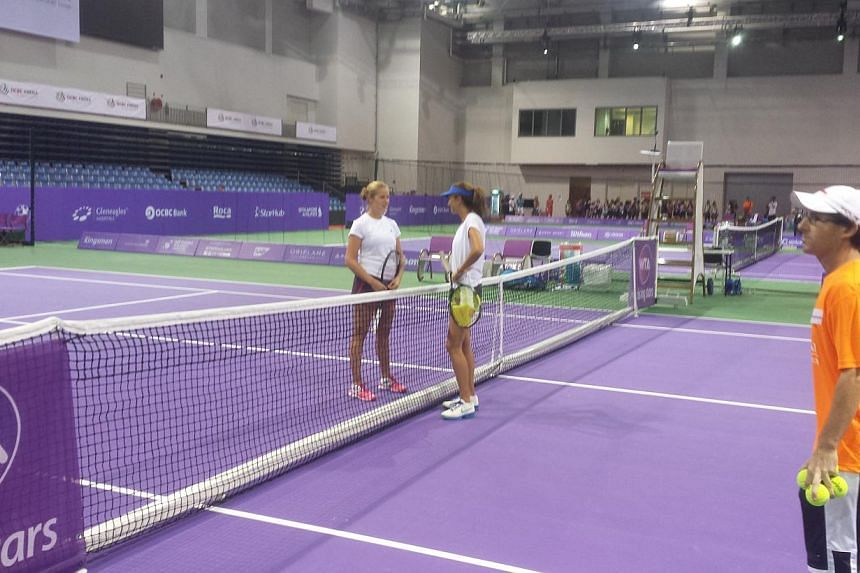 Grand Slam champion Iva Majoli (right) withAmerican 70th seed Shelby Rogers (left). -- ST PHOTO: Daryl Chin