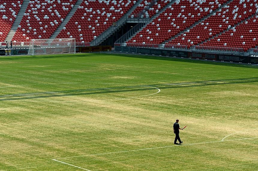 An Oct 13,2014. photo of the National Stadium's pitch shows a patchy surface. The poor quality of the pitch has forced the cancellation of the Maori All Blacks' clash with the invitational Asia-Pacific Barbarians on Nov 15. -- ST PHOTO: JAM