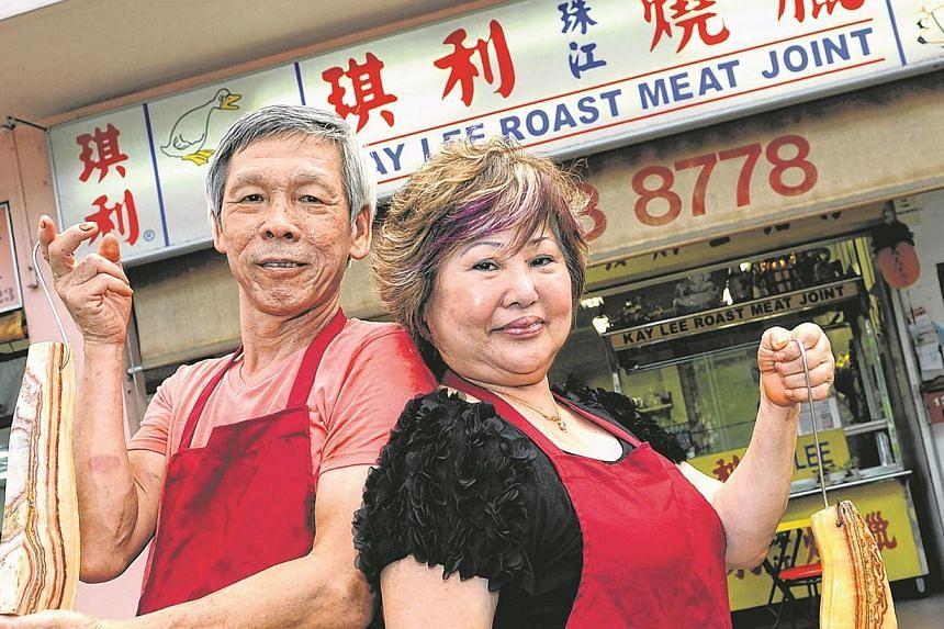 Madam Betty Kong, 66, and her husband, Mr Hai Wai Kay, 62, outside their Kay Lee Roast Meat Joint at Upper Paya Lebar Road. -- ST PHOTO:CHOO CHWEE HUA