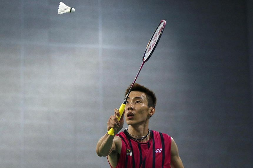 Malaysia's Lee Chong Wei returns a shot against China's Lin Dan during the men's singles semi-final badminton match at Gyeyang Gymnasium at the 17th Asian Games in Incheon on Sept 28, 2014. -- PHOTO: REUTERS