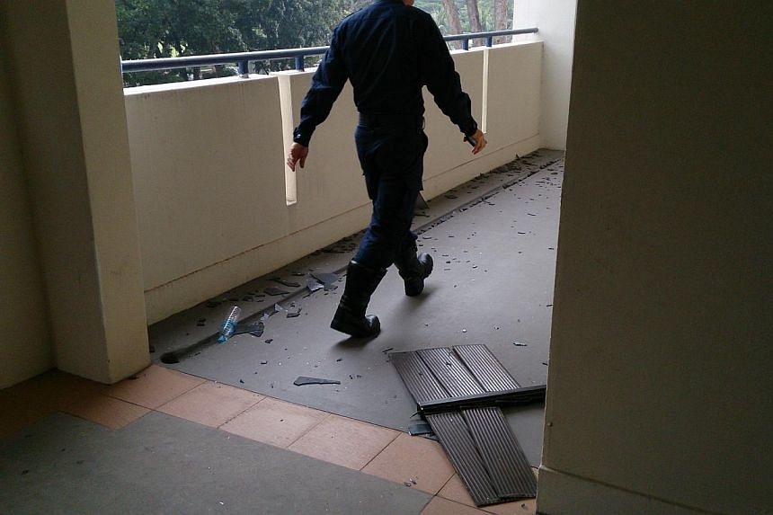 A suspected gas explosion this morning at a flat in Ang Mo Kio caused a window grille to be dislodged.-- ST PHOTO: DESMOND FOO