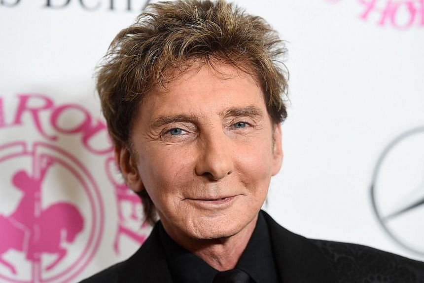Recording artist Barry Manilow attends the 2014 Carousel of Hope Ball presented by Mercedes-Benz at The Beverly Hilton Hotel in Beverly Hills, Californiaon Oct 11, 2014. -- PHOTO: AFP