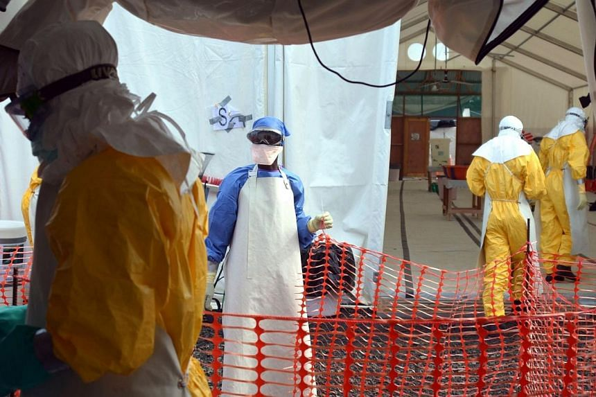 Liberian health workers are seen at the NGO Medecins Sans Frontieres (Doctors Without Borders) Ebola treatment center in Monrovia on Oct 18, 2014.The World Health Organisation's (WHO) emergency committee on Ebola will meet on Wednesday to revie