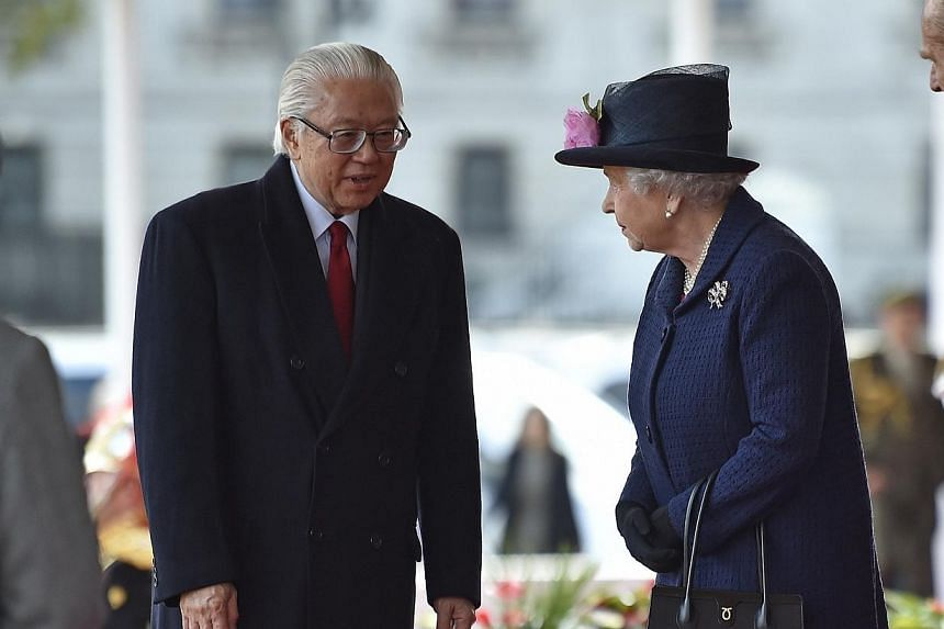 Britain's Queen Elizabeth and Prince Philip (right) greet the President of Singapore Tony Tan and his wife Mary Chee (left) during a ceremonial welcome at Horse Guards Parade in London on Oct 21, 2014. -- PHOTO: REUTERS