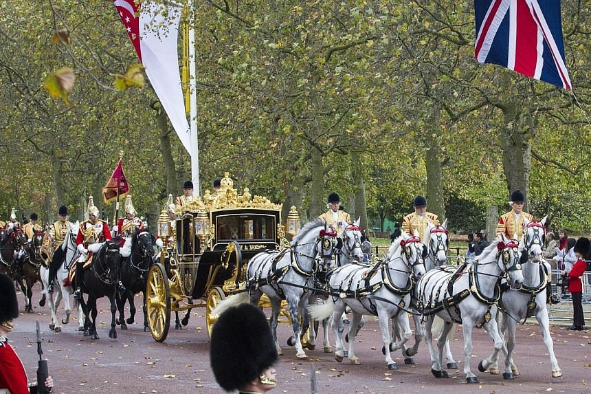 A picture shows the procession of state carriages carrying Singapore's President Tony Tan Keng Yam and his wife Mary, Britain's Queen Elizabeth II and Prince Philip, Duke of Edinburgh and Prince William, Duke of Cambridge, and Catherine, Duchess of C