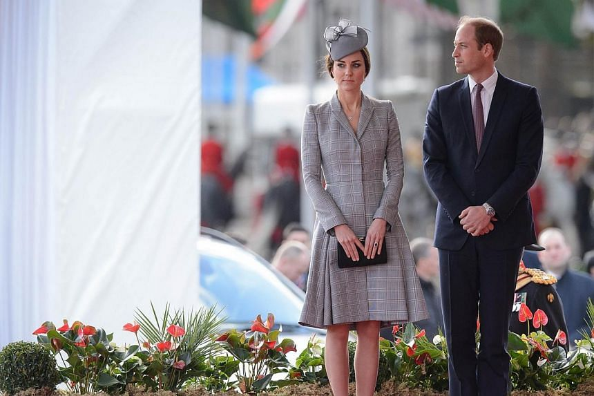 Britain's Catherine, Duchess of Cambridge (left) and Prince William, Duke of Cambridge (right) attend the ceremonial welcome ceremony for Singapore's President Tony Tan Keng Yam at the start of a state visit at Horse Guards Parade in central London o