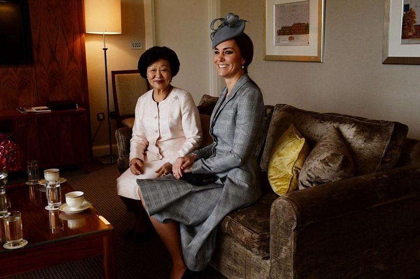 Britain's Catherine, Duchess of Cambridge (right), sits with Mary Tan (left), wife of Singapore's President Tony Tan Keng Yam, at the Royal Garden Hotel in London on Oct 21, 2014, ahead of the official ceremonial welcome at the start of the Singapore