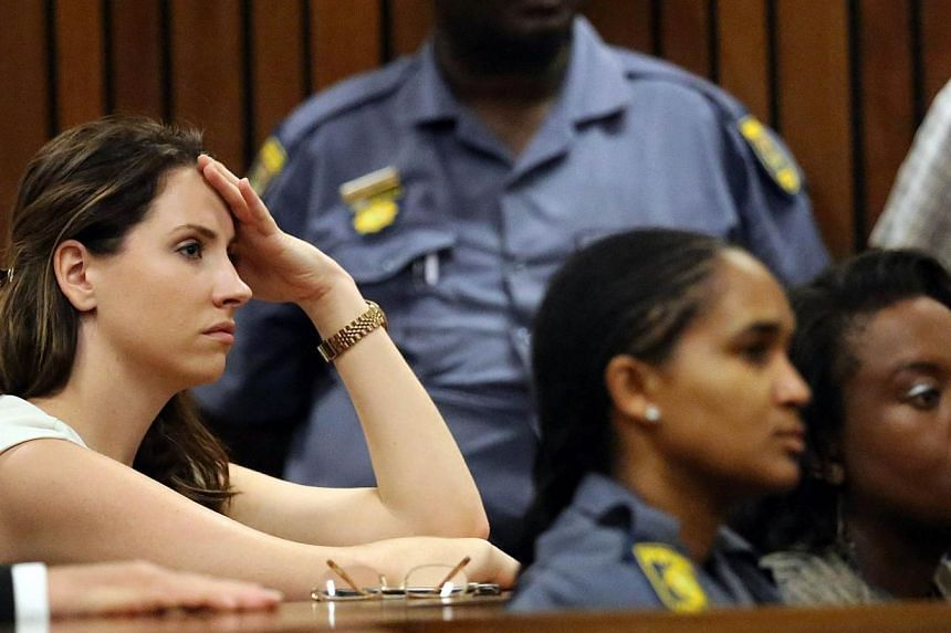 Aimee Pistorius (left) the sister of South African Paralympic athlete Oscar Pistorius attends his sentencing at the high court in Pretoria on Oct 21, 2014. -- PHOTO: AFP