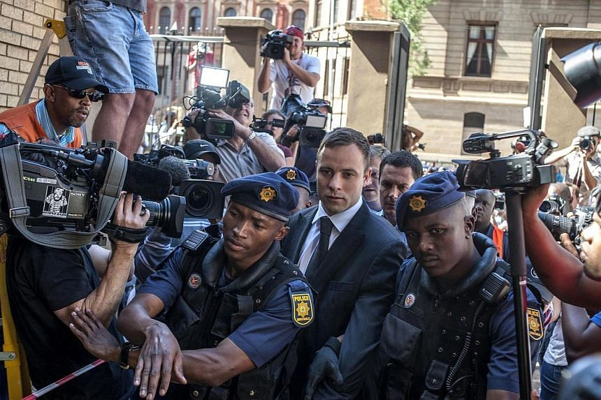 South African Paralympic athlete Oscar Pistorius arrives at the High Court in Pretoria on Oct 21, 2014. -- PHOTO: AFP