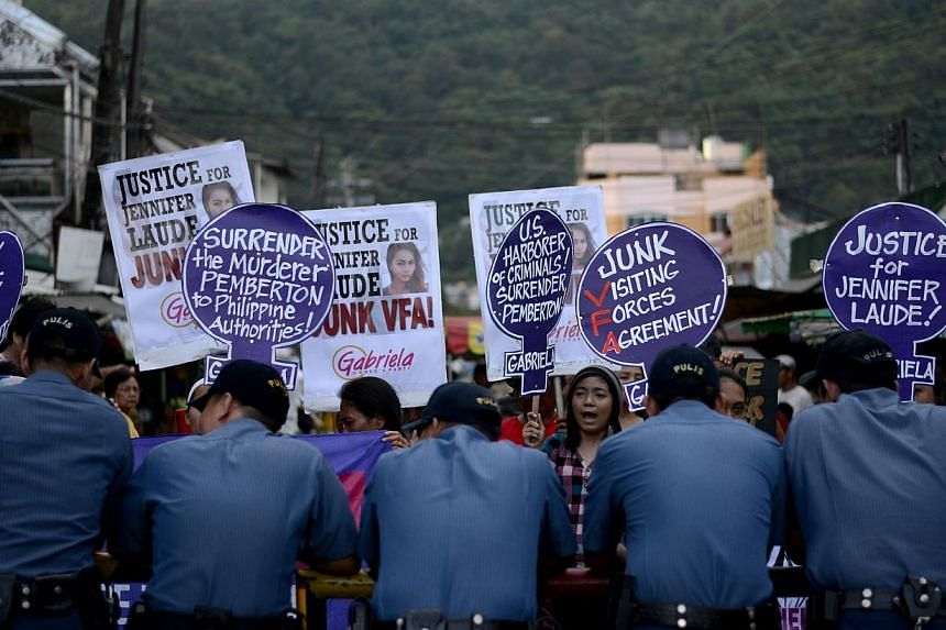 """Supporters of murdered Filipino transgender Jeffrey Laude, also known as """"Jennifer"""", hold a protest near the Hall of Justice where the preliminary hearing for the murder case is being held at the northern Philippine city of Olongapo on Oct 10, 2014.&"""