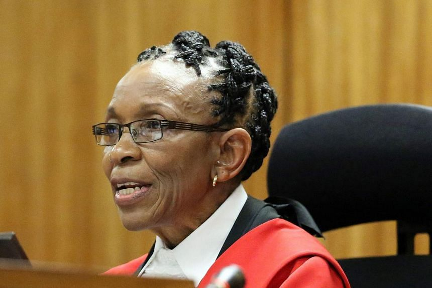 Judge Thokozile Masipais, reads her judgement against South African Paralympic athlete Oscar Pistorius at the High Court in Pretoria, on Oct 21, 2014. -- PHOTO: AFP