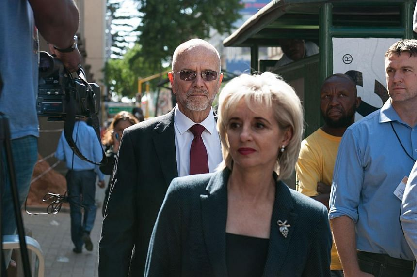 South African Paralympian athlete Oscar Pistorius's uncle Arnold and his wife Louis arrive at the High Court in Pretoria, on Oct 20, 2014. -- PHOTO: AFP
