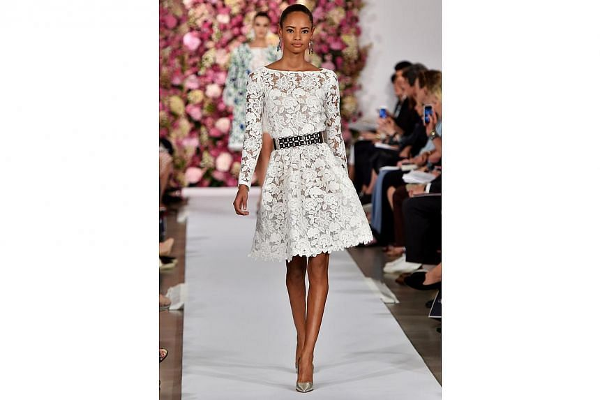 A model walks the runway at the Oscar De La Renta fashion show during Mercedes-Benz Fashion Week Spring 2015 on Sept 9, 2014, in New York City. -- PHOTO: AFP