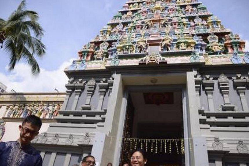 A  tour of Sri Thendayuthapani Temple is conducted after the official ceremony to gazette it as a national monument on Oct 20, 2014. -- ST PHOTO: MARK CHEONG