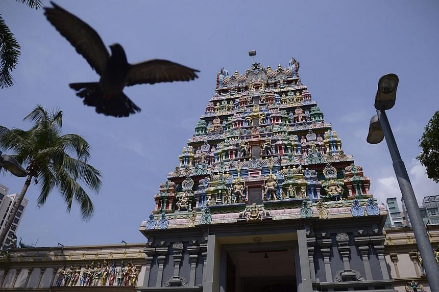 A pigeon flies in front of Sri Thendayuthapani Temple after the official ceremony to gazette it as a national monument on Oct 20, 2014. -- ST PHOTO: MARK CHEON
