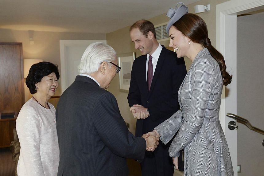 Britain's Prince William (second, right) and his wife Catherine, Duchess of Cambridge (right), greet the President of Singapore Tony Tan and his wife Mary Chee, at the Royal Garden Hotel in London on Oct 21, 2014. -- PHOTO: REUTERS