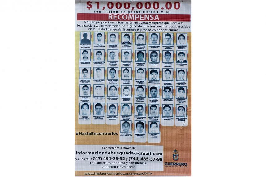 Picture of a poster with pictures of the 43 missing students offering a reward for any information is seen in Cocula, Guerrero State, Mexico, on Oct 20, 2014.Mexico's government has announced a US$110,000 (S$137,533) reward for information in t
