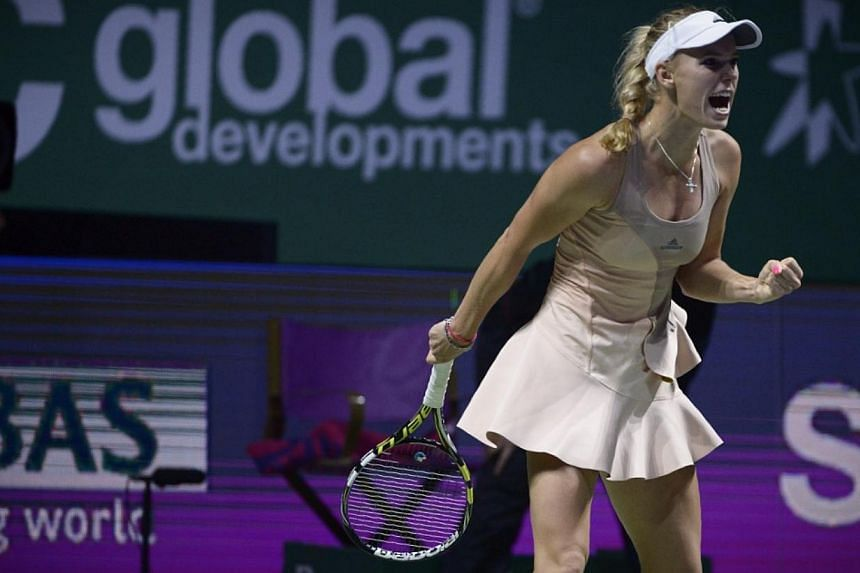 Maria Sharapova opens her WTA Finals with a clash against Caroline Wozniacki (pictured) on Oct 21, 2014. -- ST PHOTO:MARK CHEONG