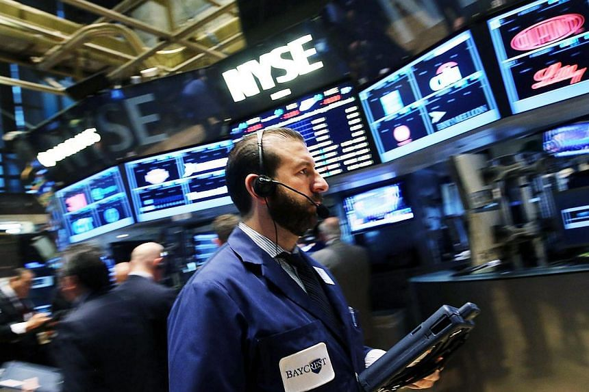 The turbulence that hit the global stock markets last week seems to have died down, with Wall Street making a strong comeback on Friday and Asian markets rallying on Monday. -- PHOTO: AFP