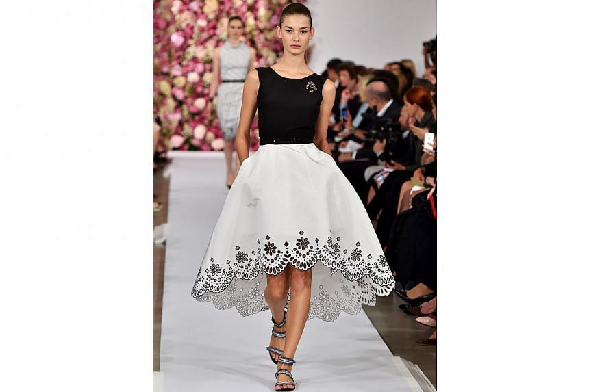 A model walks the runway at the Oscar De La Renta fashion show during Mercedes-Benz Fashion Week Spring 2015 in New York City on Sept 9, 2014. -- PHOTO: REUTERS