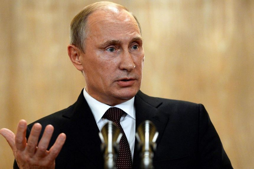 Russian President Vladimir Putin proposed to Poland's then leader that they divide Ukraine between themselves as far back as 2008, Poland's parliamentary speaker Radoslaw Sikorski said in an interview published by the US Politico website. -- PHOTO: A