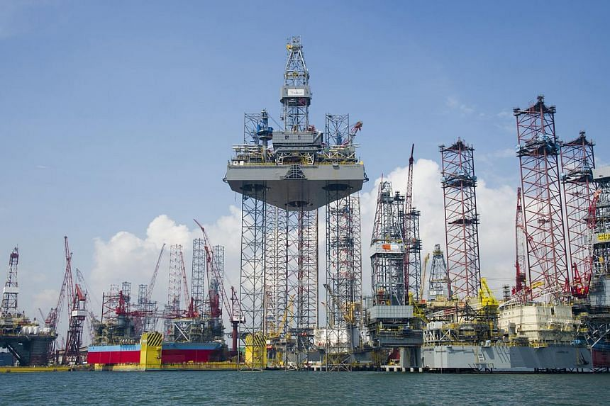 A Keppel FELS yard in Singapore. Property curbs in Singapore and China dragged down third quarter net profit at conglomerate Keppel Corp, which also builds oil rigs and infrastructure projects around the world. -- PHOTO: KEPPEL CORPORATION