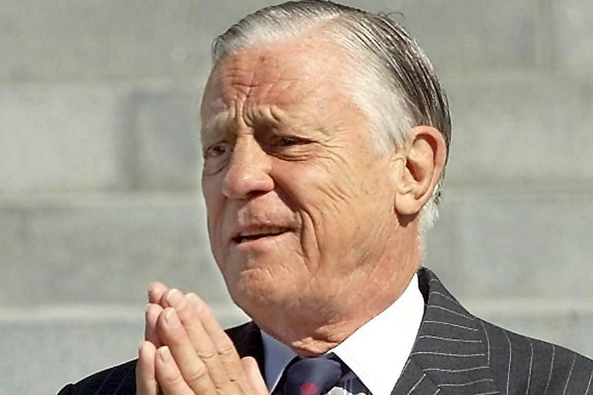 A 2001 photo of former Washington Post Executive Editor Ben Bradlee arriving at the Washington National Cathedral to attend the funeral service for former Post chairman Katharine Graham in Washington, DC. Bradlee, who oversaw the paper's coverage of