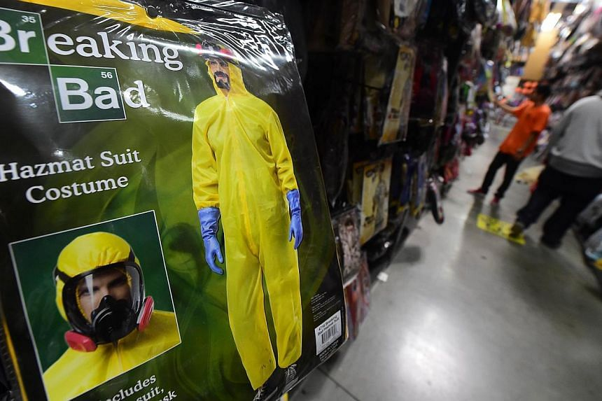 The 'Breaking Bad Hazmat Suit' costume on the racks at the Halloween Club store in Montebello, California on Oct 16, 2014 ahead of the annual end of the month tradition on Oct 31, 2014. -- PHOTO: AFP