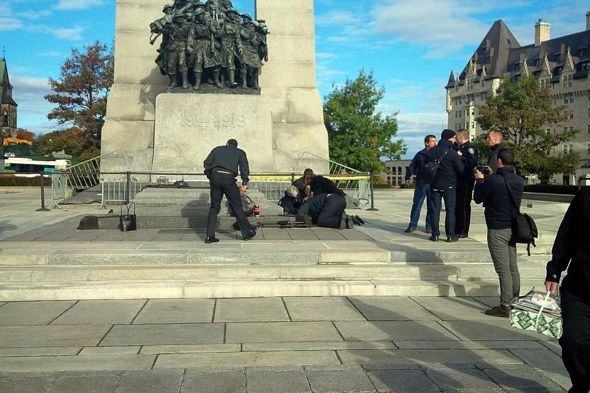 A Canadian soldier who was shot outside the war memorial on Parliament Hill in tended to in Ottawa on Oct 22, 2014. -- PHOTO: REUTERS