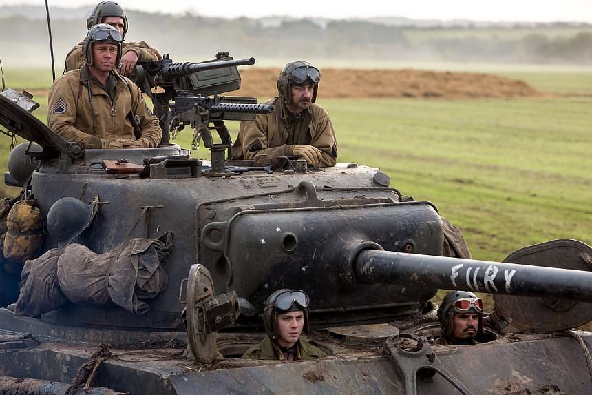 Movie still from Fury starring Brad Pitt, Shia LeBeouf, Logan Lerman. -- PHOTO: SHAW