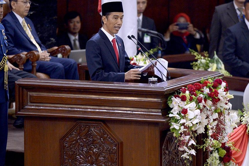 Mr Joko Widodo delivers his speech as President of Indonesia on Oct 20, 2014. -- ST PHOTO: LIM SIN THAI