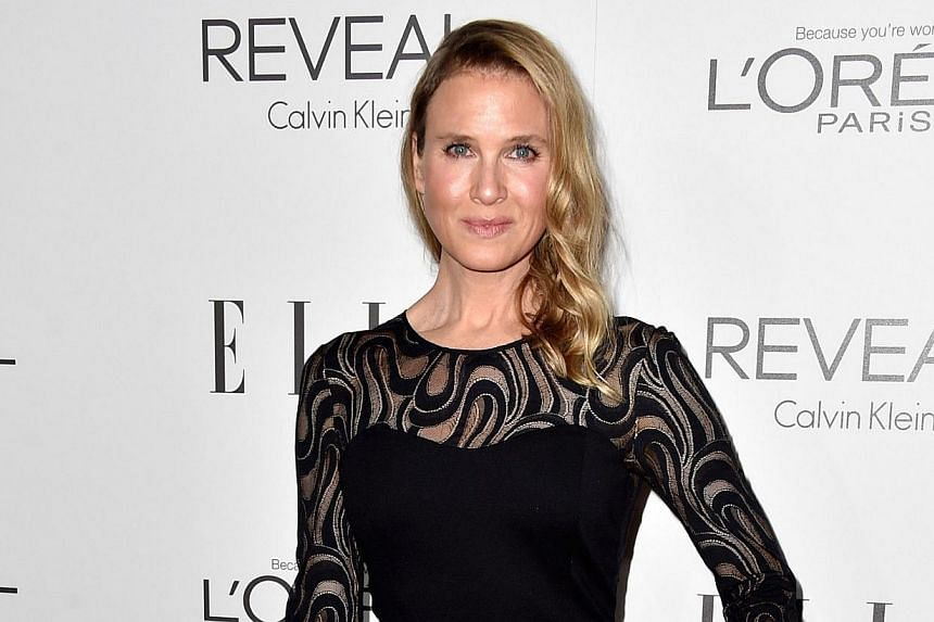 Actress Renee Zellweger arrives at Elle's 21st Annual Women In Hollywood at the Four Seasons Hotel Los Angeles on October 20, 2014 in Beverly Hills, California. -- PHOTO: AFP