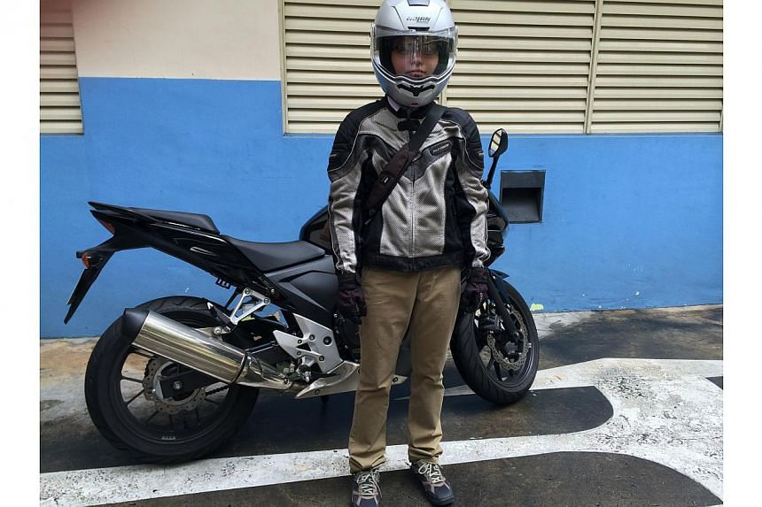 Ms Cheryl Ong with her motorcycle. A recent survey found that nearly three in four motorcyclists in Singapore have had an accident before, and most admit that the accidents were of their own doing.-- ST PHOTO: CHERYL ONG