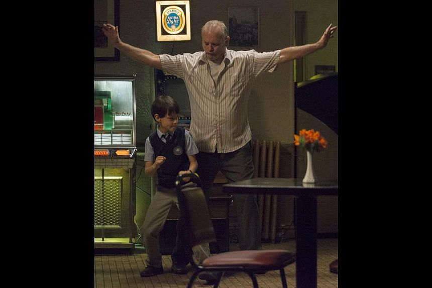 Bill Murray plays Vincent, who babysits a 12-year-old (Jaeden Lieberher, both above) to pay off his gambling debts.