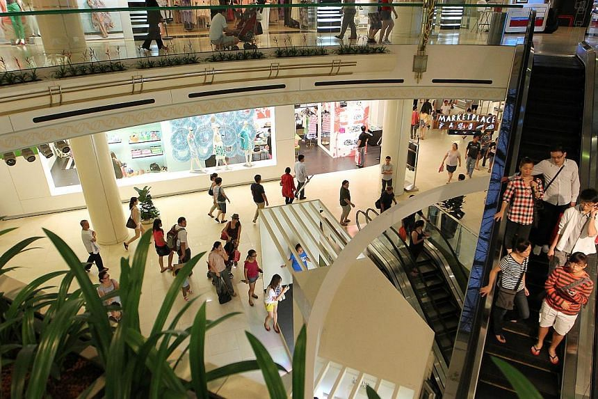 Shoppers seen inside Raffles City Shopping Centre on 2012. -- PHOTO: ST FILE