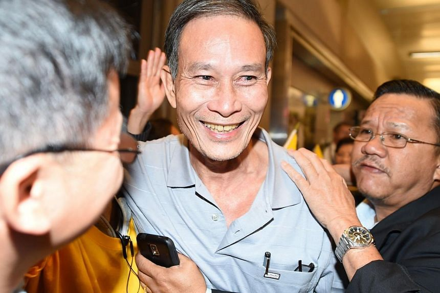 Freed Vietnamese dissident Nguyen Van Hai is greeted upon arrival at Los Angeles International Airport in Los Angeles, California on Oct 21, 2014. -- PHOTO: AFP
