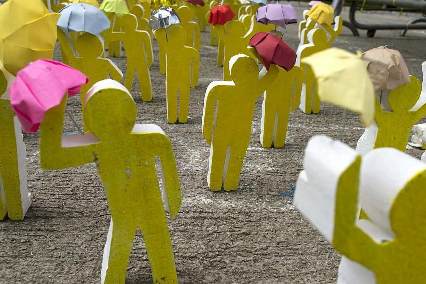 An art installation made from wood and paper depict the scene of Occupy Central protesters holding up their umbrellas outside the government headquarters in Hong Kong on Oct 20, 2014. -- PHOTO: REUTERS