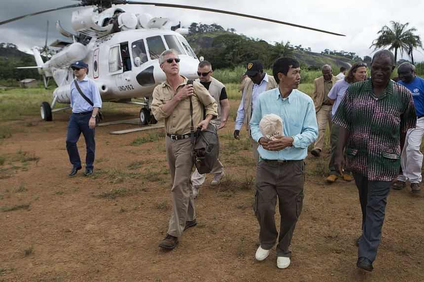Anthony Banbury (2nd left), Special Representative and Head of the United Nations Mission for Ebola Emergency Response to Liberia, arrives at Foya in Lofa County on Oct 2, 2014. -- PHOTO: REUTERS
