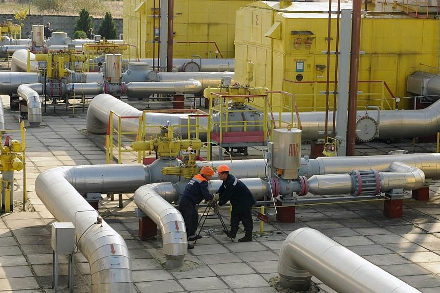 Employees at work near an underground gas storage in the village of Opari, some 70 kms south-west from Lviv. Ukraine must pay $3.9 billion if it wants Moscow to resume supplies of natural gas, Russia's Energy Minister Alexander Novak said today. -- P