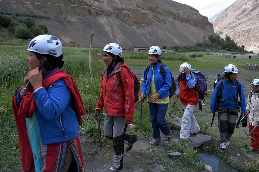 In this photograph taken on August 4, 2014, Pakistani students from the Shimshal Mountaineering School prepare to climb near the Shimshal village in the northern Hunza valley. Breaking taboos and pursuing jobs traditionally done by men, the first bat