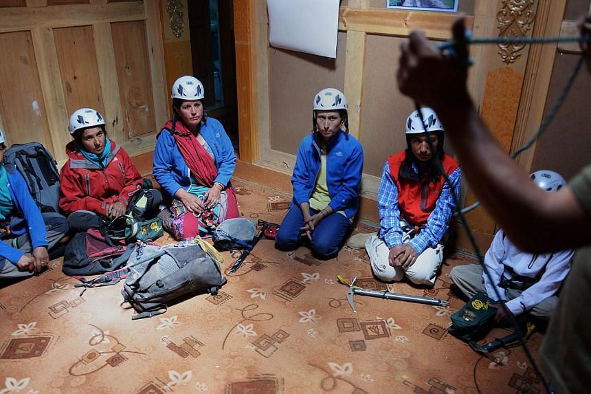 In this photograph taken on August 4, 2014, Pakistani students take part in a lesson at the Shimshal Mountaineering School in Shimshal village in the northern Hunza valley. Breaking taboos and pursuing jobs traditionally done by men, the first batch