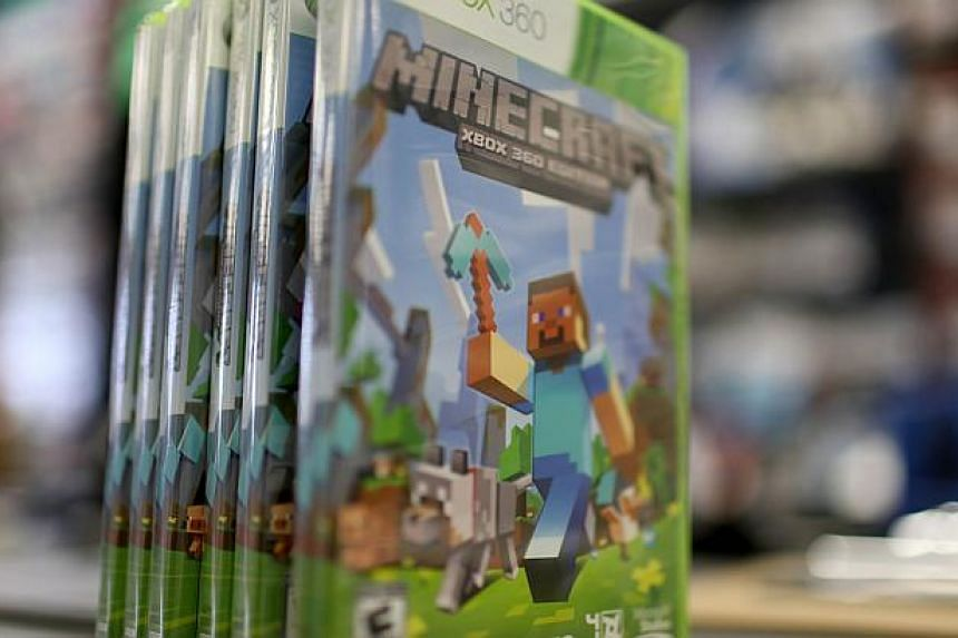 An XBox 360 Minecraft game is seen at a GameStop store on Sept 15, 2014 in Miami, Florida. -- PHOTO: AFP