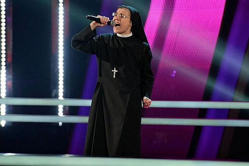 Sister Cristina Scuccia performing during the The Voice Of Italy competition in June, in Milan. -- PHOTO: AFP