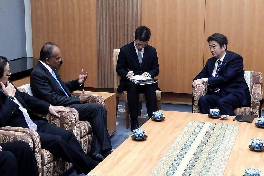 Minister K Shanmugam (second, left) calling on Japanese Prime Minister Shinzo Abe (right). -- PHOTO: MINISTRY OF FOREIGN AFFAIRS